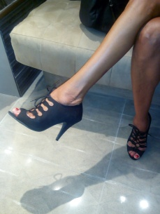 Nice shoes and red pedicure.